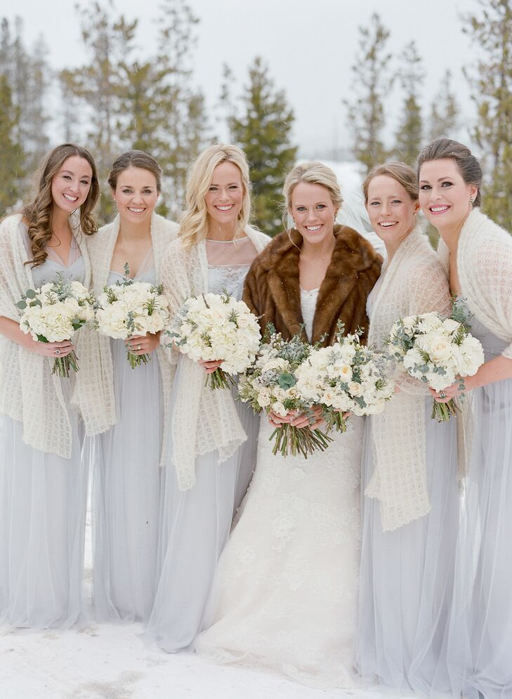 Wanting to honor a natural color scheme that matched the rustic mountain landscape, Charlotte chose a floor-length Amsale tulle bridesmaid gown in dove blue. Each bridesmaid also wore a handmade shawl to help keep them warm through all the photos outside in the snow.