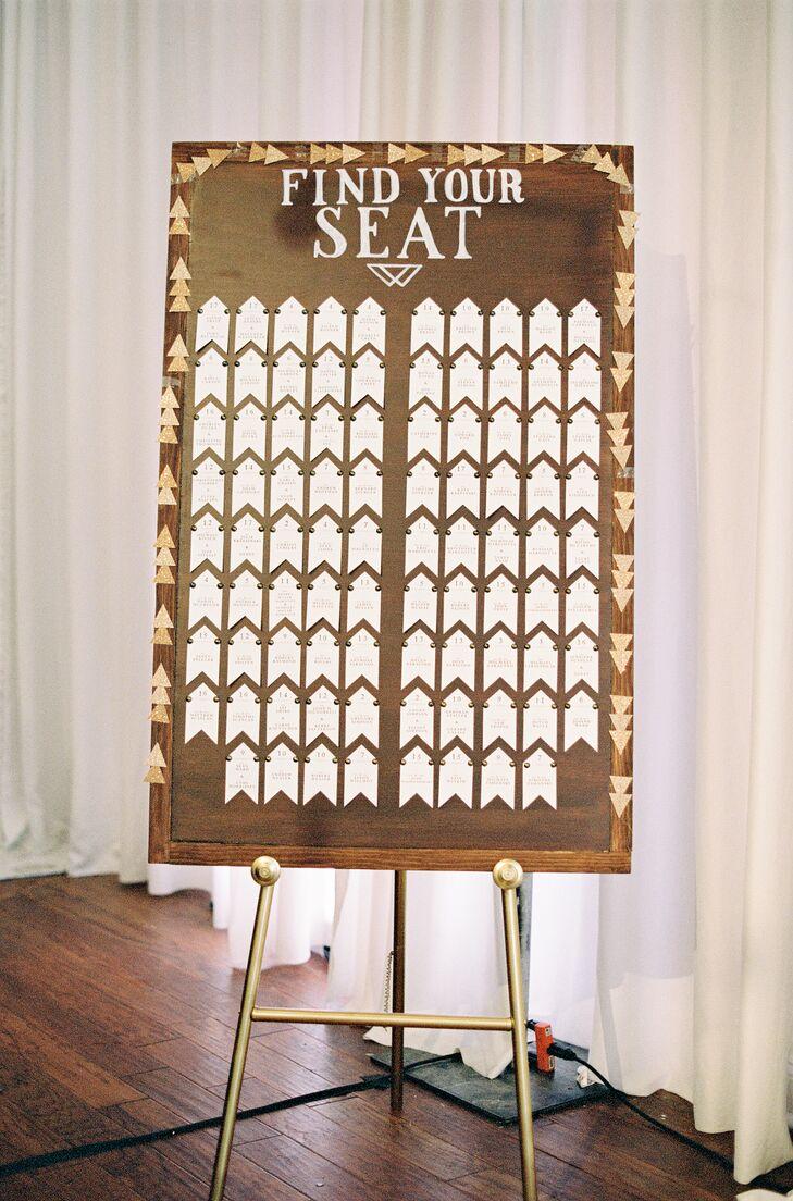 Arrow-Shaped Escort Cards on Wood Backdrop