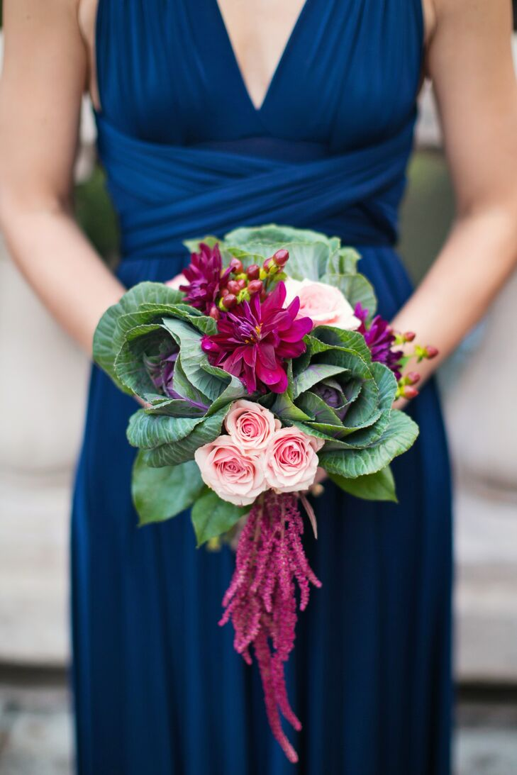 The bridesmaids' bouquets were made with pink garden roses, wine hypericum berries, wine dahlias, hanging amaranthus and kale hand tied with twine.