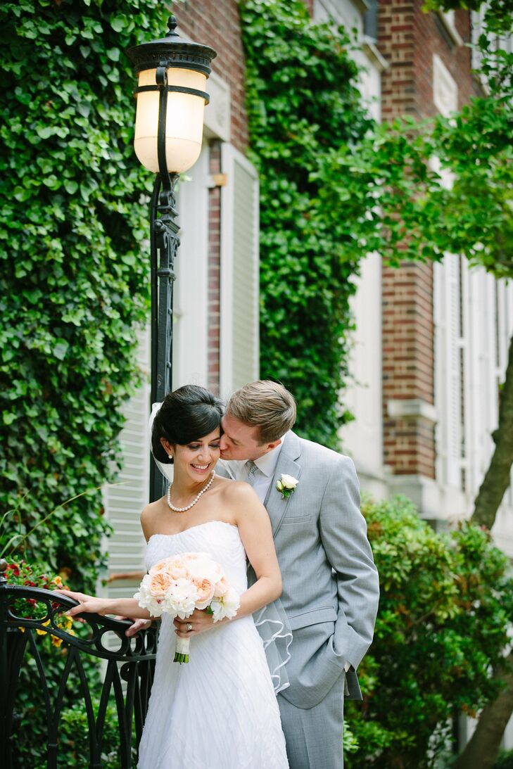 """""""I wanted a simple, classic, soft look that would suit a garden wedding,"""" Carey says. This silk, A-line Nicole Miller gown gave her that classic bridal look."""