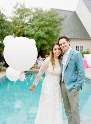 Couple Holding Balloons and Posing by Pool During Backyard Microwedding in Potomac, Maryland