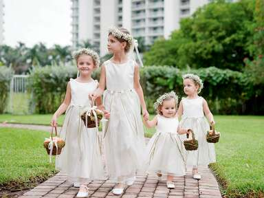 Flower girls in white dresses and flower crowns