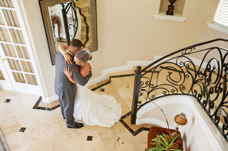 Bride and Groom Embrace on a Marble Staircase during First Look