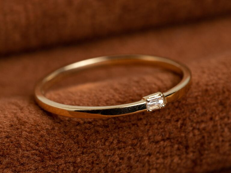 Minimalist baguette diamond ring with yellow gold band