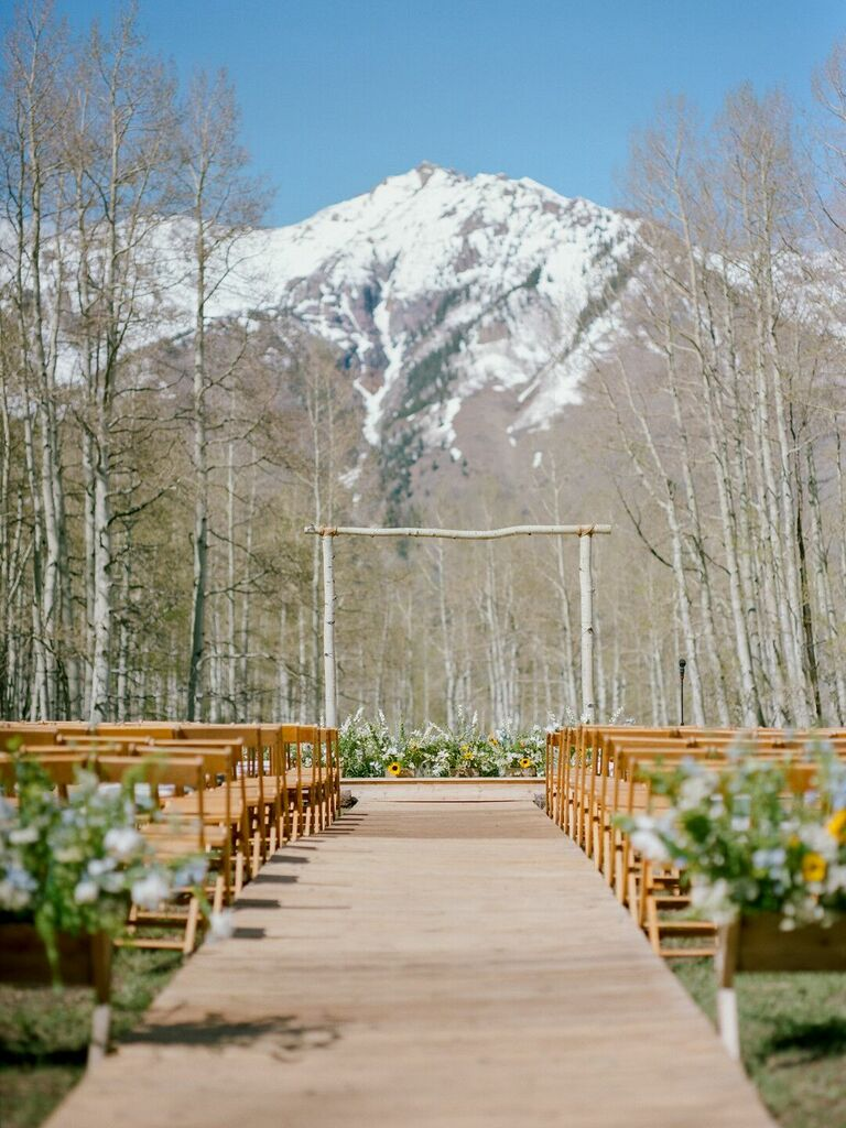Rustic ceremony with sunflower accents and mountain backdrop