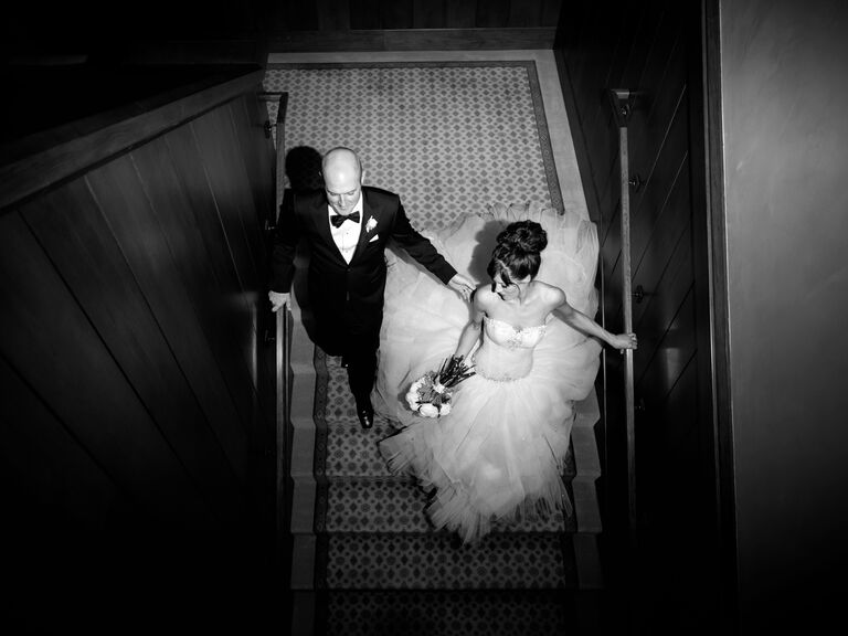 Overhead black and white wedding photography of bride and groom
