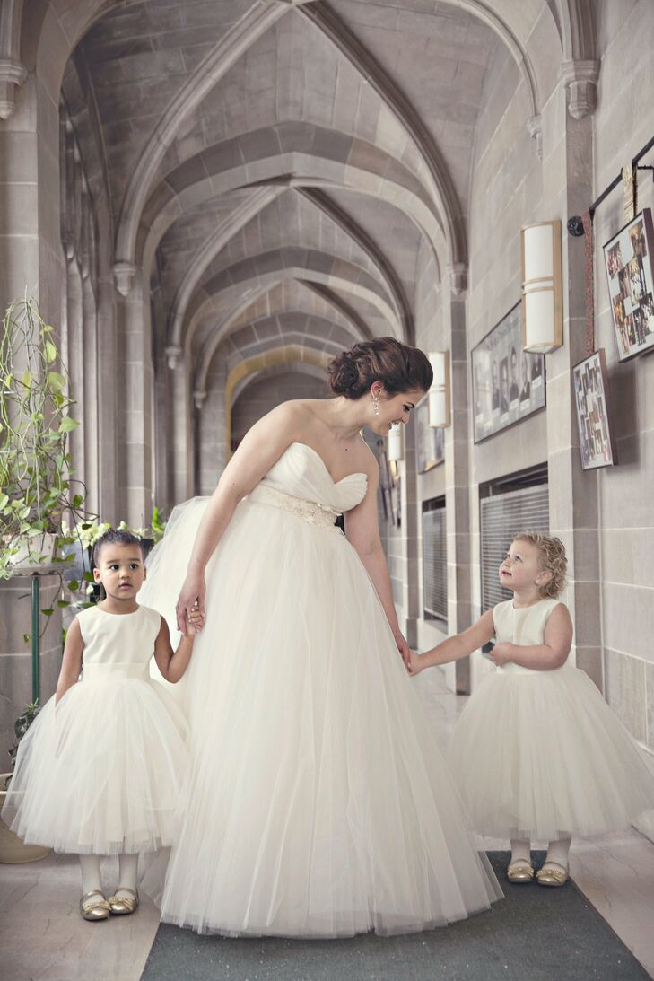 Emily's mother hand-stitched the flower girl dresses, designing each to look like the bride's ivory tulle ball gown.