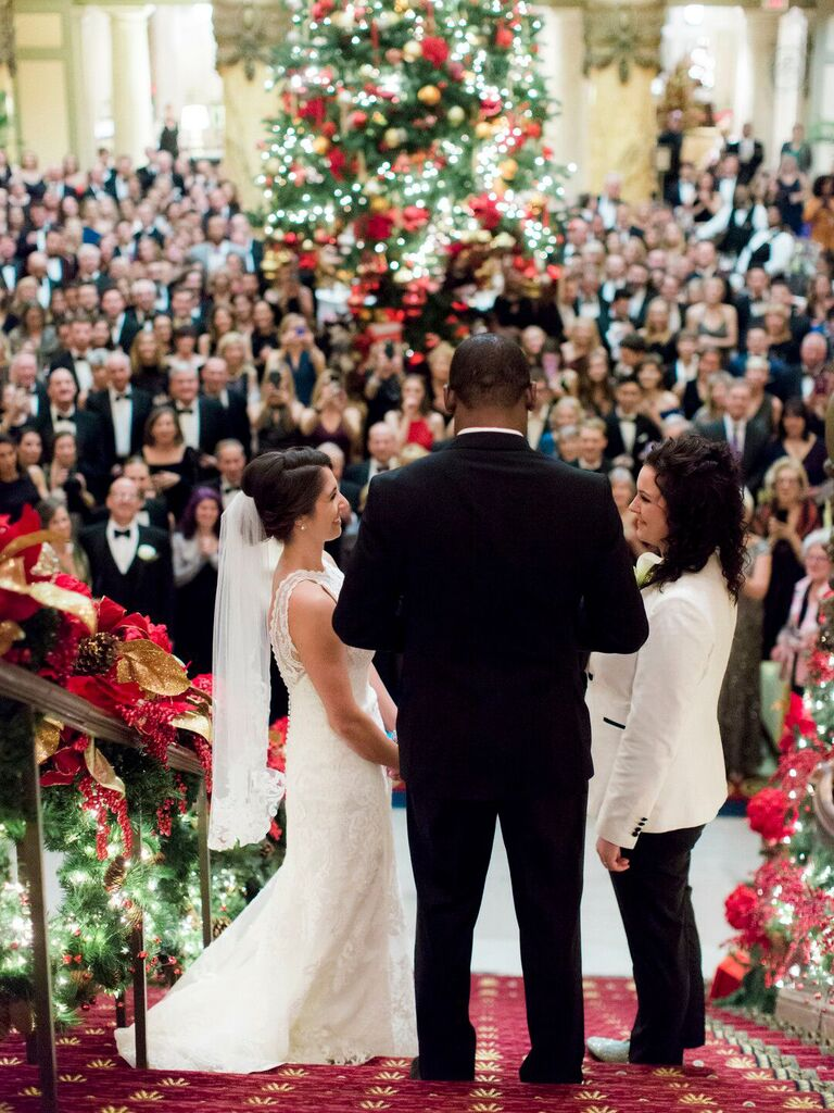 how to choose wedding vendors couple at christmas wedding on stairs