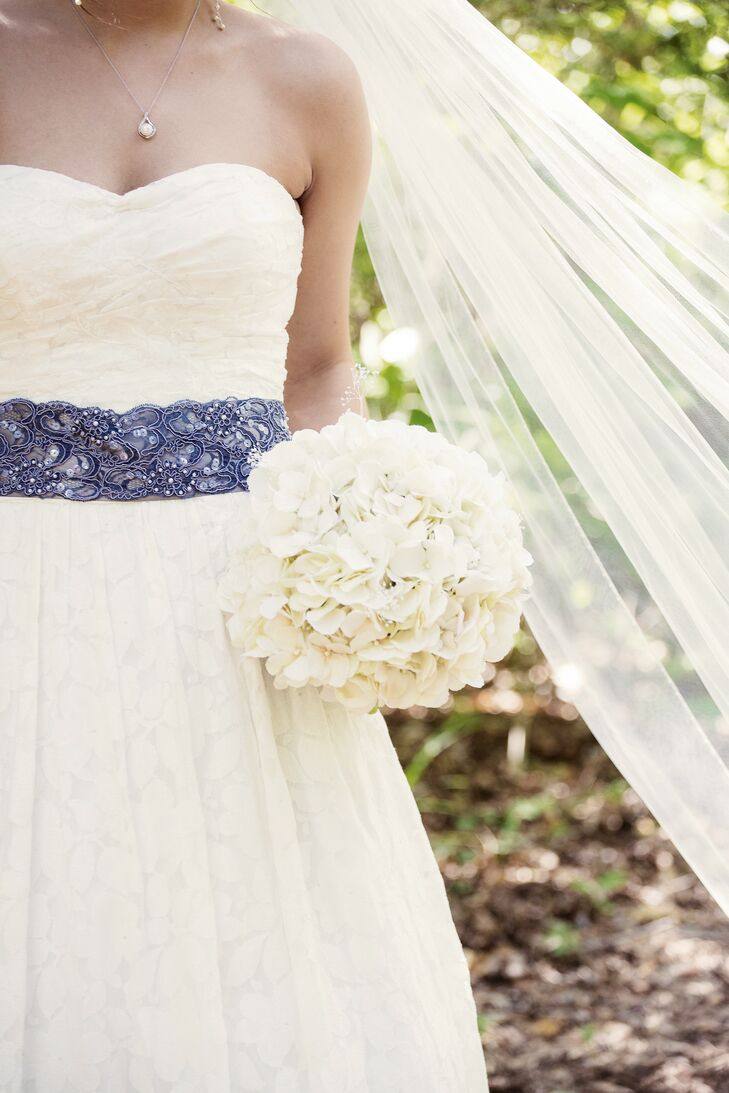 wedding dress with blue lace sash