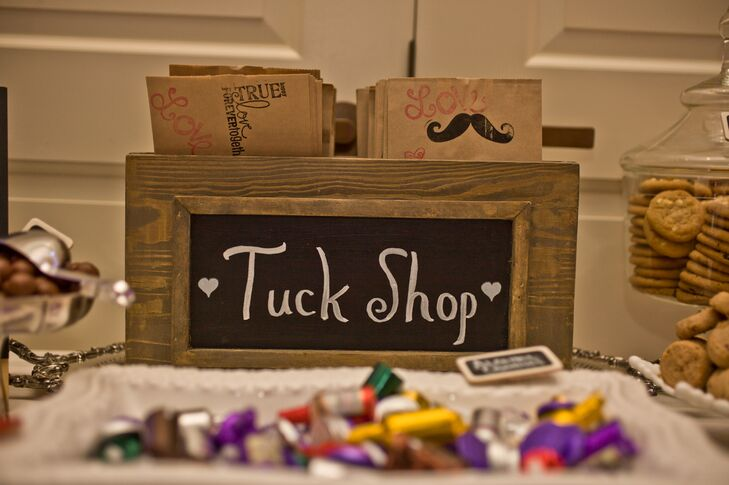 "Jennie and Patrick called their candy bar a ""Tuck Shop,"" and they provided their guests with playful goodie bags that were stamped with mustaches."