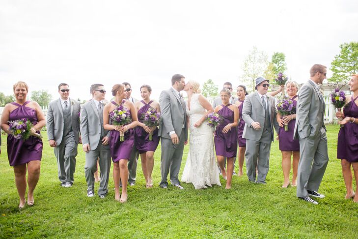 """The groomsmen wore gray three-piece suits while the bridesmaids wore short purple dresses. """"I knew I wanted a short dress for my bridesmaids in a deep plum color,"""" Sara says. """"I originally wanted one-shoulder, but once I saw the neckline on the dress I chose, I fell in love with it."""""""