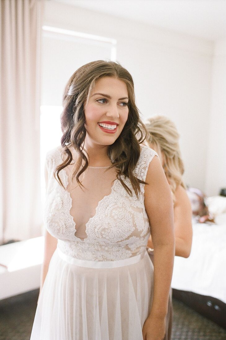 "When wedding dress shopping with her mom, Marissa walked inside Brickhouse Bridal and told the attendant she wanted to try on the Watters Santina dress, ""and that is the dress I wore on my wedding day."" Details include an illusion neckline, plunging back, covered buttons, hand-placed lace, satin ribbon and an amaretto lining under nude-colored tulle and ivory lace."