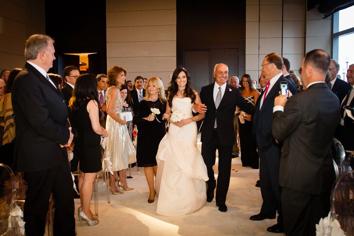 Allison opted for two different dresses to transition her look from the ceremony to the reception. For her walk down the aisle, she donned a blush pink Monique Lhuillier modified trumpet gown with dramatic draping and a strapless, sweetheart neckline. She ditched the traditional veil and adorned her long flowing locks with a Jenny Packham headpiece. Her second dress was a vintage-inspired Jenny Packham design with a sheath silhouette, draped cap sleeves and beaded embellishments that exuded old world glamour.