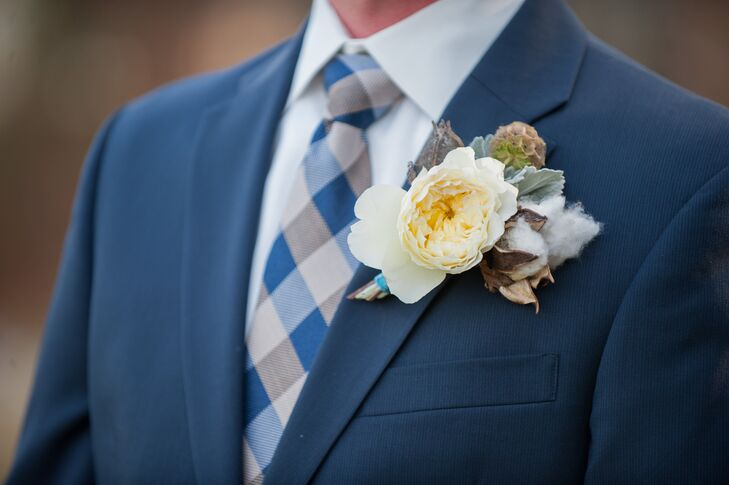 To complement the textured, autumnal bridesmaid bouquets, the florists at Flora Fauna Designs created cotton, garden rose, scabiosa pod and lamb's ear boutonnieres for Donal and his groomsmen to pair with their stylish navy suits. The boutonnieres were finished with blue velvet ribbons to match the one adorning Jill's bridal bouquet.