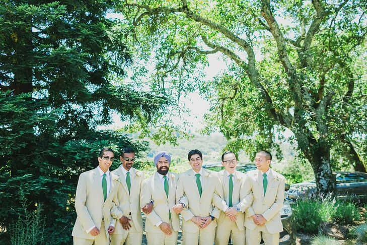 "Vishal wore a bespoke tan suit and shirt with brown leather shoes. His groomsmen wore slightly lighter tan Tommy Hilfiger suits with green ties and brown shoes. ""We chose these suit colors because it was a mid-July outdoor wedding in California with the ceremony taking place in the 3 p.m. sun,"" Emily says. ""It was hot!"""