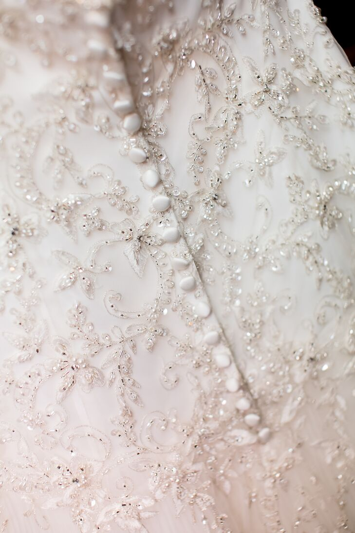 The bride's dress had sequins and pearls embroidered onto the bodice. The back of the dress had pearl button details.