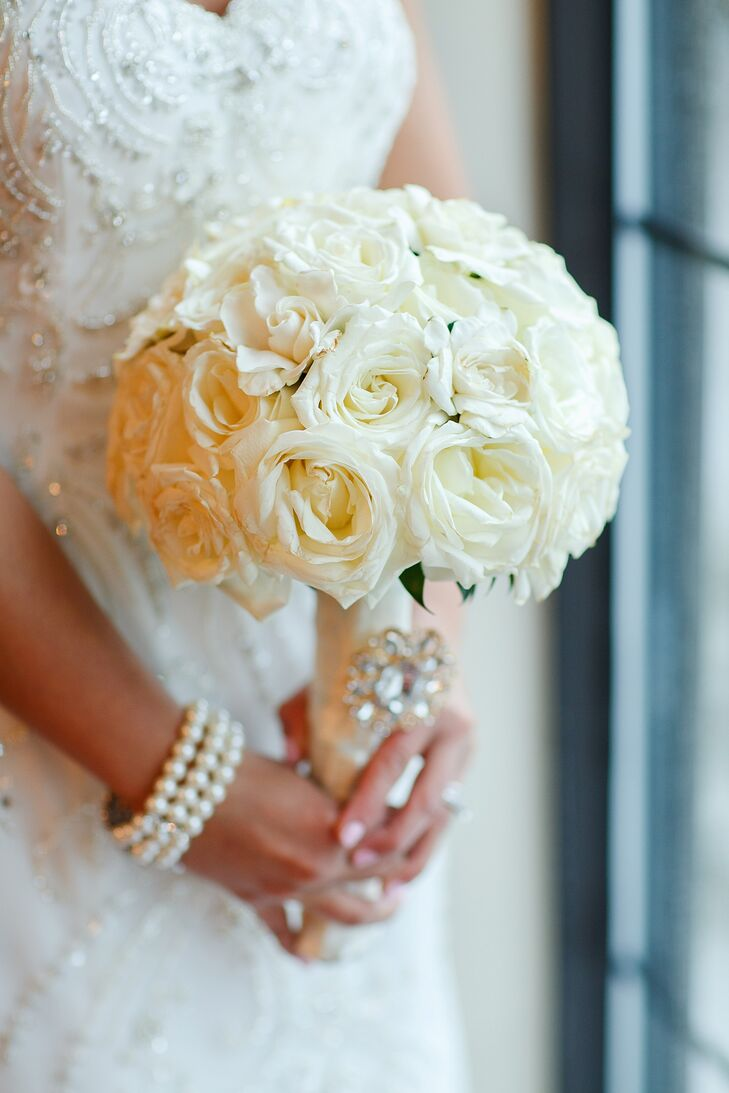 Bella Flora of Westmont, Illinois, created a classic bridal bouquet using a fresh mix of ivory roses that were then paired with an elegant satin bouquet wrap.