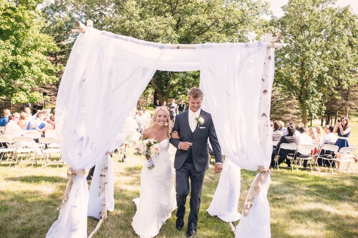 """""""We didn't have to do much to decorate the ceremony space,"""" the bride says. """"There was already so much natural beauty to work with. Outside of an arbor and a few burlap bows on chairs, we didn't touch the space."""""""