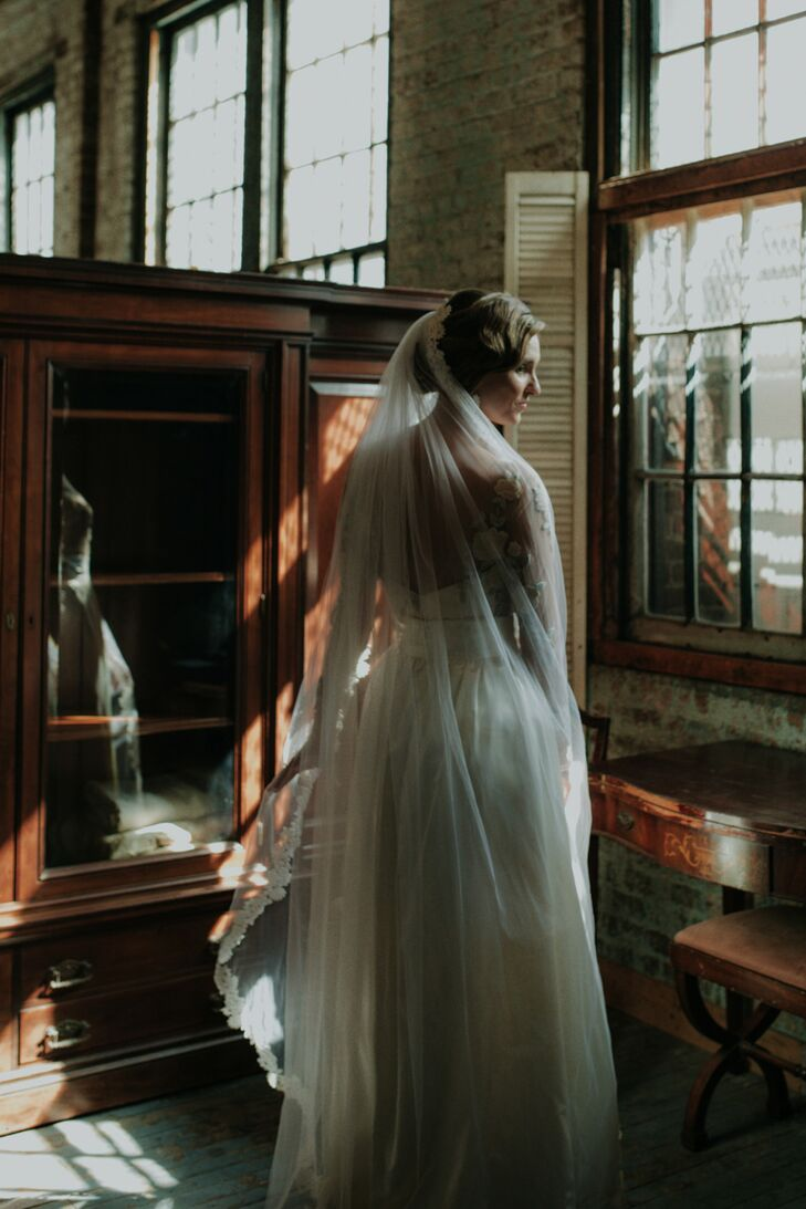 Romantic Bride in Vintage Dress with Veil