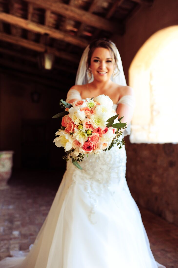 Nicole's textured bouquet included Juliet garden roses, ivory dahlias, cinnamon roses, coral ranunculus and soft greenery. Her florist, Butterfly Petals, tied in some native Arizona flowers with some of the more big and bountiful varieties Nicole envisioned.