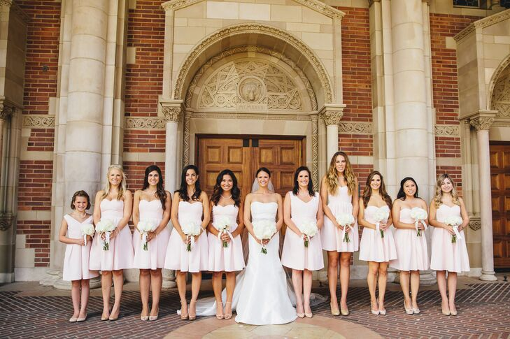 """""""The bridesmaids donned blush pink dresses from J.Crew, and the groomsmen wore black tuxes with light pink bow ties,"""" says the couple."""