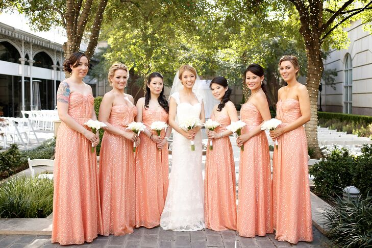 Chloe's bridesmaid dresses channeled the chic-luxe wedding style. The women wore coral pink floor-length dresses with splashes of gold and carried all-white calla lily bouquets for a modern touch.