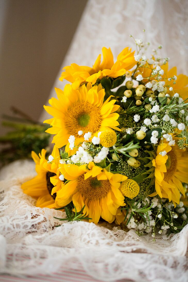 All the bouquets held by Meredith and her bridesmaids had bright yellow sunflowers mixed with baby's breath—a warm bouquet for a happy day.