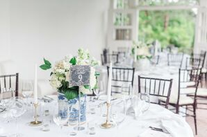 Elegant White Dining Table with Taper Candles, Flowers and Table Number
