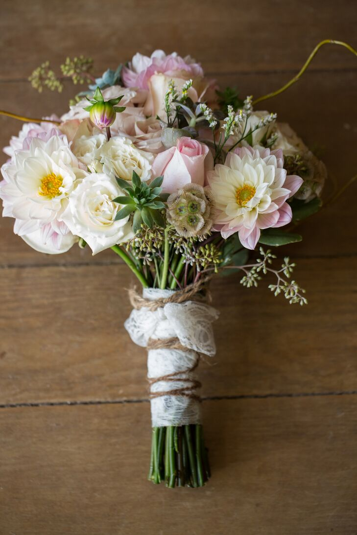 Stephanie carried a bouquet with white and pink roses, white chrysanthemums, succulents, scabiosa pods and seeded eucalyptus. The bouquet was wrapped in lace and twine.