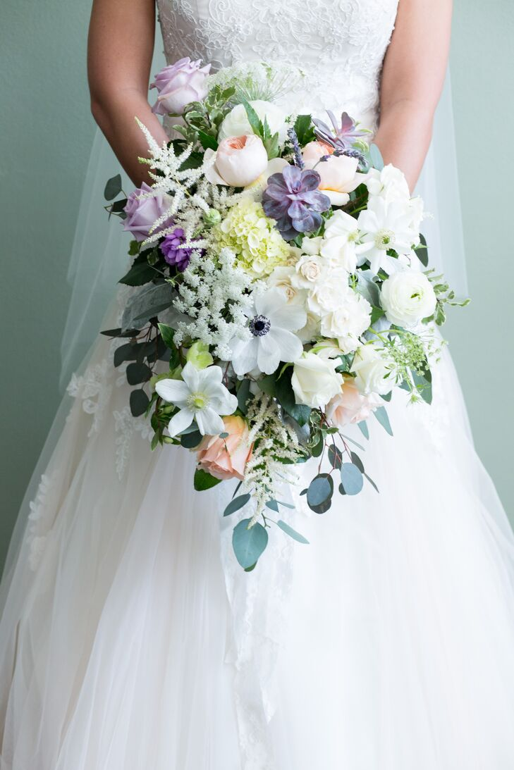 In keeping with the theme of whimsical romance, Dana carried a lush, cascading bouquet in shades of white, ivory, blush, peach and lavender. The flower arrangement was made up of peonies, hydrangeas, roses, ranunculus, astilbes, succulents, Queen Anne's lace and eucalyptus leaves.