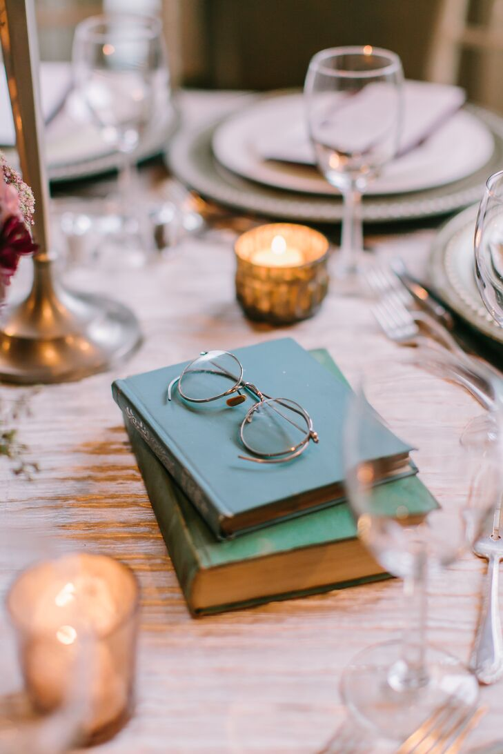 To emphasize the evening's old-world theme, Stefanie and Christopher decorated the reception tables with vintage details such as books, brass accents and old spectacles.
