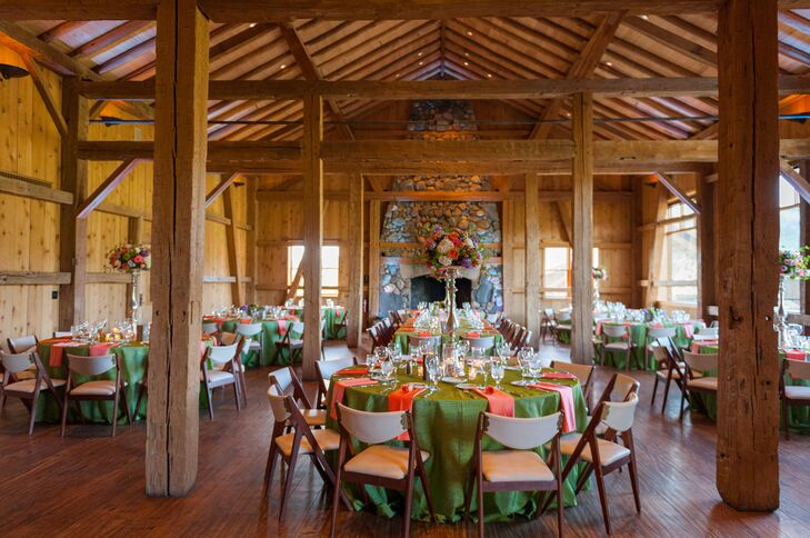Katie and Haydn decorated their reception with a mix of tall and short centerpieces to add some dimension to the room and green and orange linens for a pop of color.