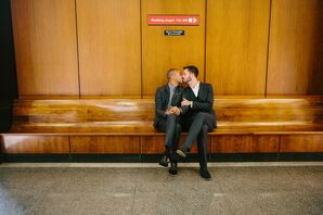 Kissing on Wooden Bench in Courthouse