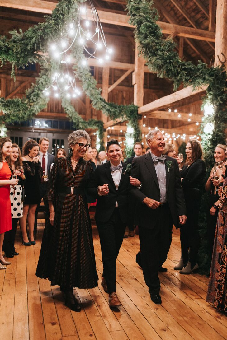 While Shane and Lexie wrote their own ceremony, the couple incorporated a number of Jewish customs into the proceeding as a nod to Shane's roots. Following tradition, Shane's walk down the aisle was a family affair, with both of his parents joining him at his side.