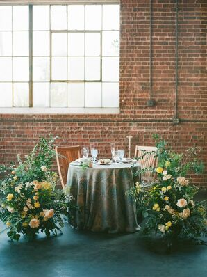 Sweetheart Table with Patterned Linens and Classic Flower Arrangements