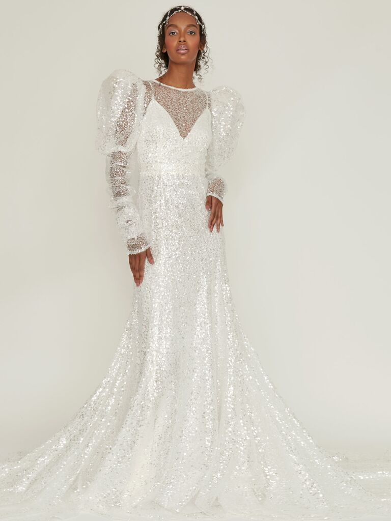 sequin tulle layered over silk satin wedding dress with puff shoulders and shirred long sleeves
