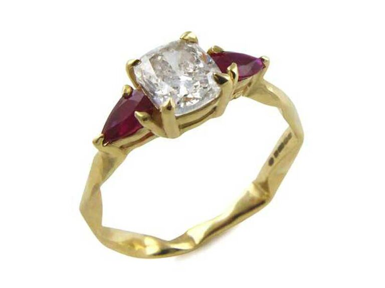 Cushion-cut diamond engagement ring with pear-cut ruby side stones
