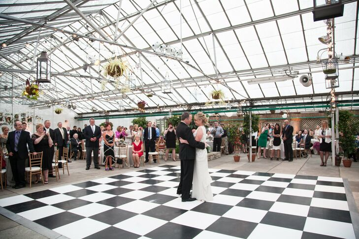 The couple hit the black-and-white checkered dance floor for their first spin as husband and wife.