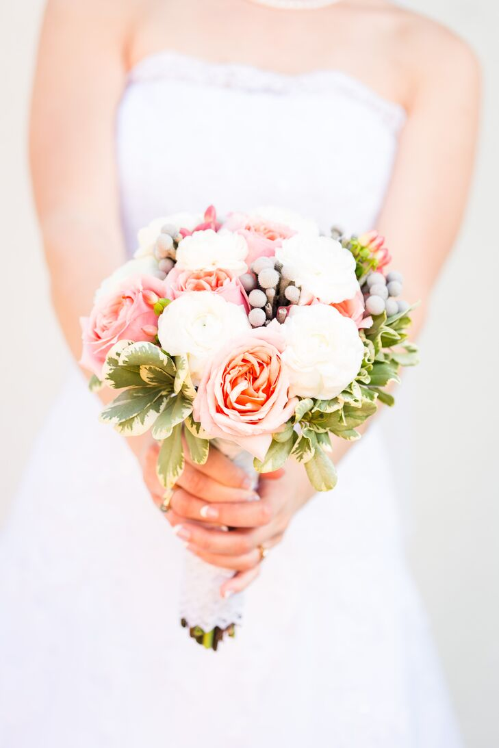 Micaela held a bouquet of Ivory and pink roses accented with greens and hypericum berries.