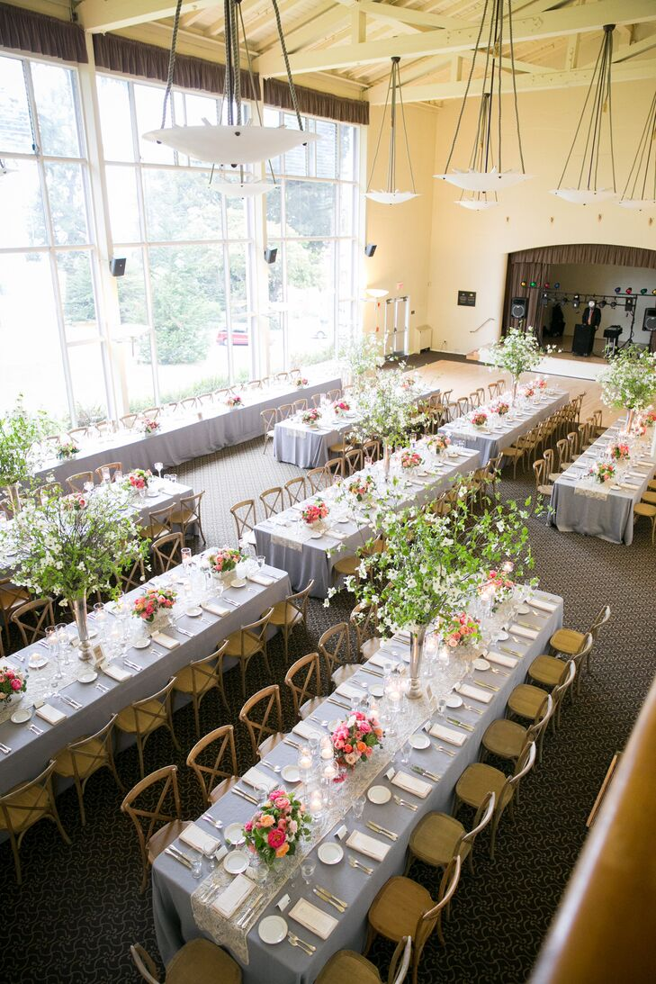 With the large windows letting natural light in, all friends and family members got a good glimpse of the surrounding urban views from Golden Gate Club in San Francisco, California. Long dining tables dressed in gray linens had lace runners draped down the middle, plus a variety of low and high flower centerpieces.