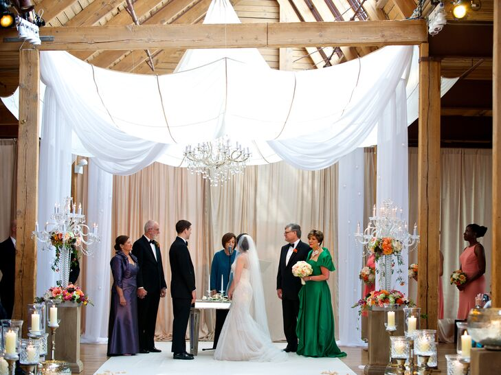 Brielle and Jonathan incorporated their families' Jewish, Protestant and Catholic traditions. They got married under a white fabric huppah, read 1 Corinthians and had a white rose ceremony, traditionally done in weddings at the groom's parish, where the the couple gives white roses to each other's mothers as thank-yous for raising their child.