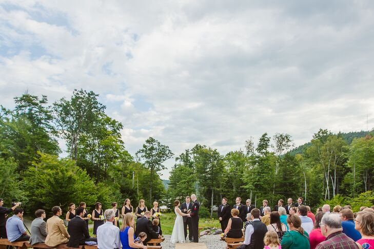 The couple's outdoor ceremony overlooked the gorgeous woods of Maine.