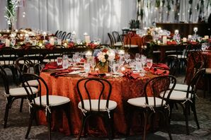 Orange Tablecloth and Wood Sweetheart Chairs