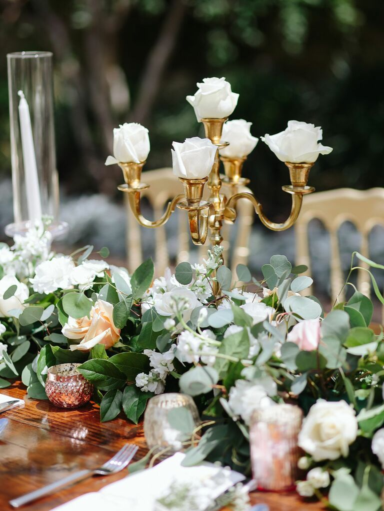 Antique gold candelabra table centerpiece with white roses
