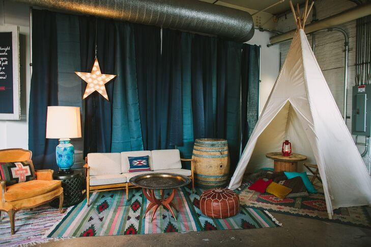 The cocktail hour and reception were decorated with large teepees, bohemian rugs, rustic wooden barrels and marquee stars to match their creative, adventure-inspired wedding theme.