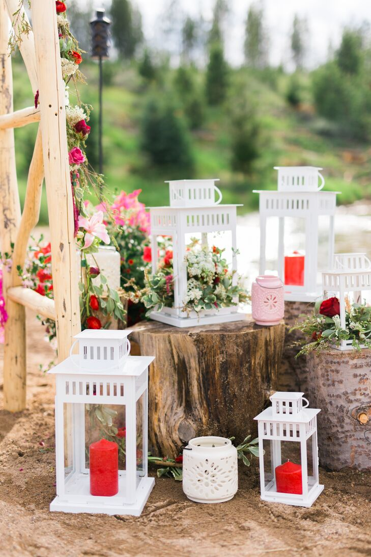 """""""Since it was the Fourth of July, we wanted to honor the holiday in our color theme without being too over the top,"""" Lindsay says. """"We chose claret red as our main shade and accented with neutrals, including white, cream and coffee."""" To add a pop of vibrant color to the vast waterfront ceremony space, Lindsay created arrangements of pink and red blooms and styled them alongside bright white lanterns that added romance as the sun began to set."""