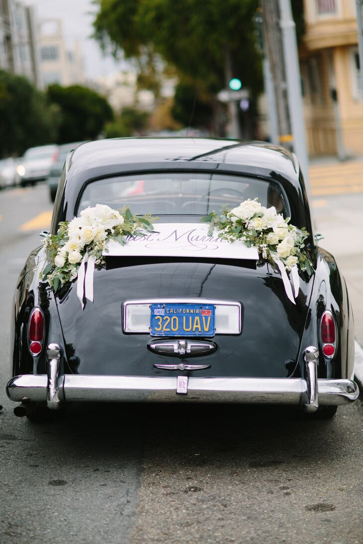 Meghan and Alex departed St. Dominic's for the reception in a vintage black Rolls-Royce topped with white flower garlands.