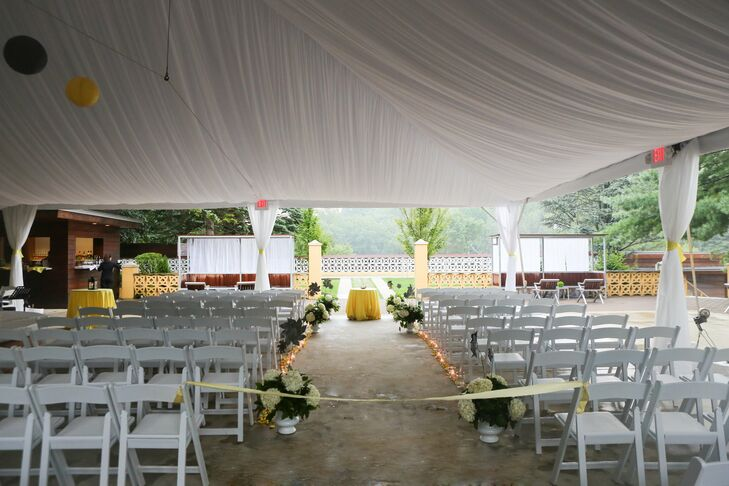 After rain squashed plans to have an outdoor ceremony, the couple tied the knot beneath a tent on the patio.