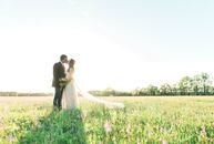 Laid-back couple Ashley Kesler (30 and a statistical programmer) and Brad Mitchell (30 and a home builder) hosted a rustic farm wedding featuring vint