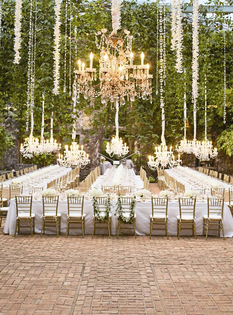 Industrial wedding space with ivy and suspended chandeliers